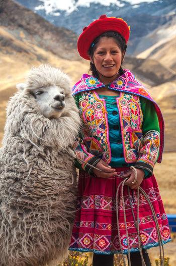 a peruvian girl with her Llama at Valle Dorado. Peru South America Culture Inca Llama Peru Peruvian Girl Puno, Perú Travel Destinations Valle Dorado