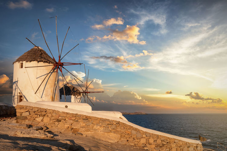 The famous traditional wimdmills of Mykonos island in Greece during sunrise Sky Water Cloud - Sky Sea Sunset Tranquil Scene Sunlight Tranquility Sunrise Mykonos Cyclades Greece Island Windmills Famous Traditional Landmarks Sunlight Tourist Attraction  Travel Destinations Summer Tourism Mediterranean  Europe Cruise