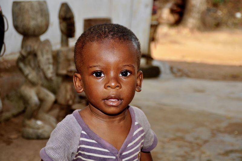 Portrait Of Cute Boy On Footpath