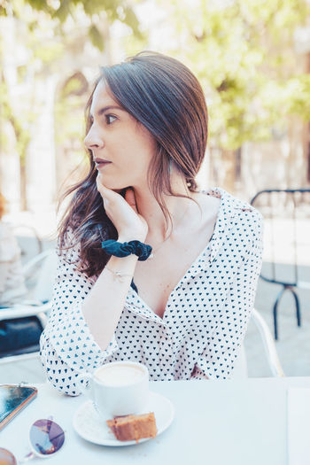 Woman looking away while coffee