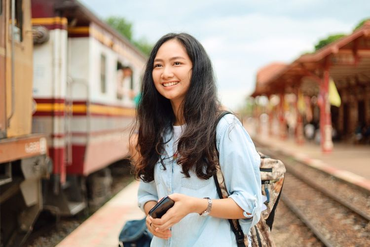Rail Transportation Young Adult Transportation Long Hair One Person Smiling Standing Waist Up Mode Of Transportation Young Women Hair Real People Railroad Track Looking At Camera Focus On Foreground Portrait Train Track Hairstyle Beauty Beautiful Woman Outdoors