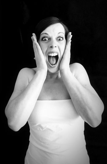 Human Body Part Mouth Open Human Mouth Looking At Camera Only Women Adult Shouting Screaming One Person Adults Only One Woman Only One Young Woman Only Young Adult Black Background Portrait People Horror Shock Front View Studio Shot Looking At Camera Beautiful Woman