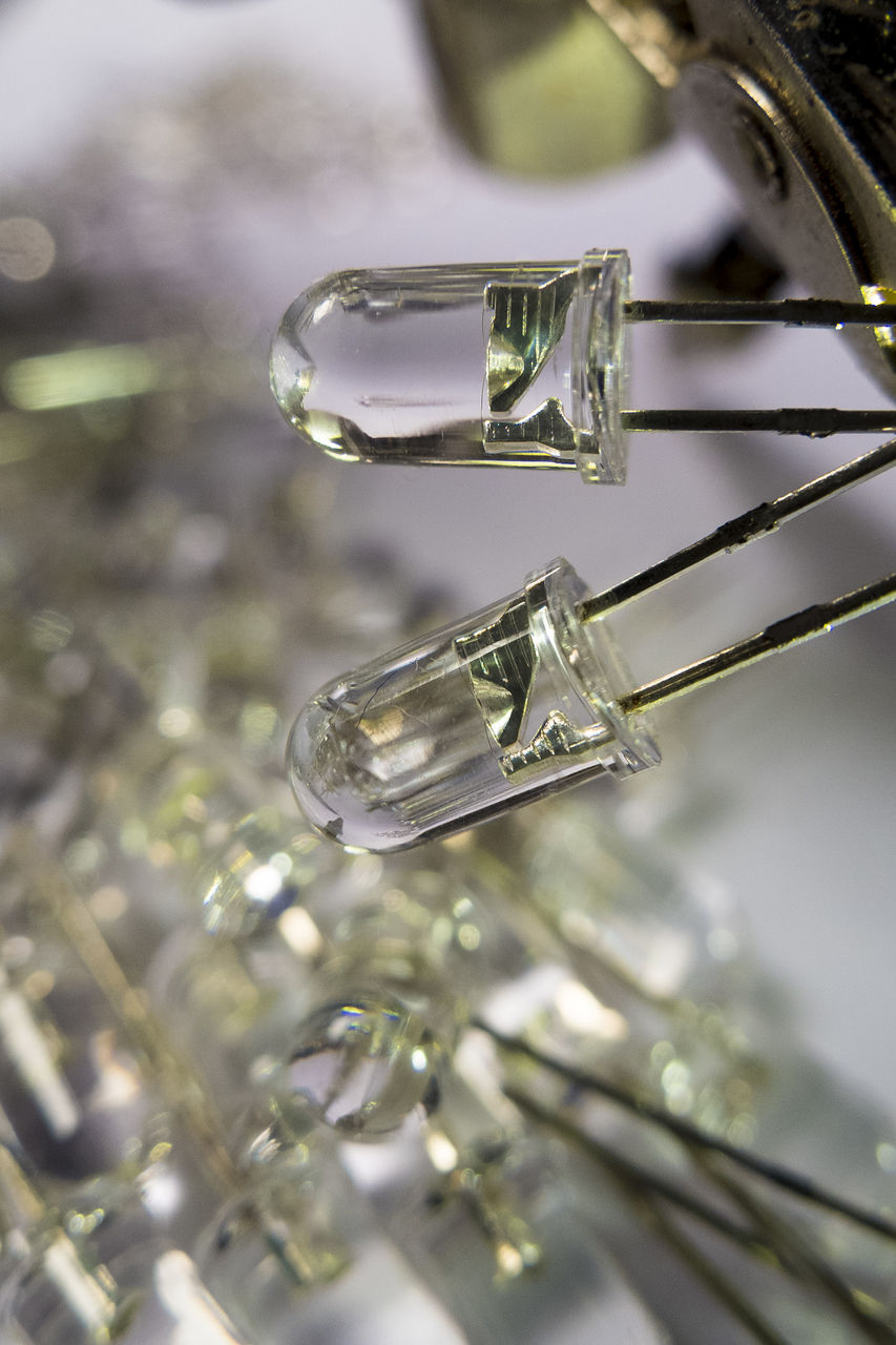 close-up, focus on foreground, no people, selective focus, metal, still life, indoors, shiny, in a row, day, crystal, detail, transparent, ice, reflection, nature, glass - material, group of objects, glass, silver colored