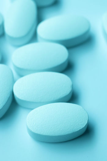 Close-up of medicines over turquoise background