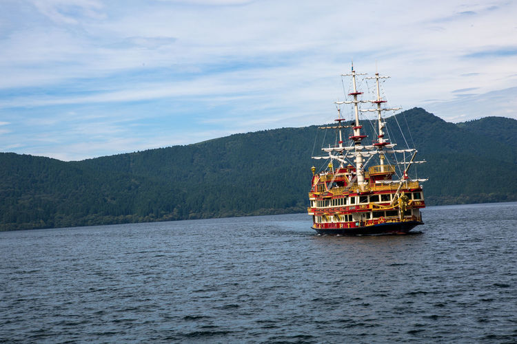 Pirate ship on Lake Ash in Hakone Lake Ashi Beauty In Nature Cloud - Sky Day Drilling Rig Hakone Industry Mountain Mountain Range Nature No People Offshore Platform Outdoors Pirate Ship Scenics Sea Sky Technology Transportation Water Waterfront