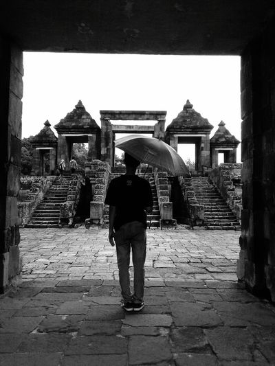 rainy at the temple Umbrella Boy