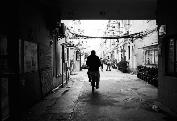 Architecture Built Structure One Person Building Exterior Building Full Length Rear View City Real People Walking Men Direction The Way Forward Street Residential District Lifestyles Footpath Day Transportation Outdoors Alley Blackandwhite Streetphotography Film Photography