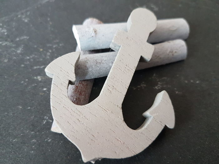 High Angle View Of Anchor On Table