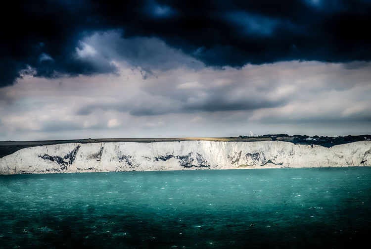 white cliffs in a scary sky EyeEmNewHere HDR Beauty In Nature Cloud - Sky Cold Temperature Day Environment Horizon Idyllic Landscape Nature No People Outdoors Overcast Scenics - Nature Sea Sky Sunkissed Sunkissed☀ Tranquil Scene Tranquility Turquoise Colored Water White Cliffs  White Cliffs Of Dover