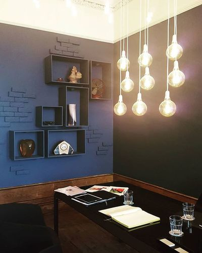 Amazing navy blue walls and (oh so) clever fixtures Meeting/Lounge room by @terracal @casaportodesignhouse CasaPorto2015