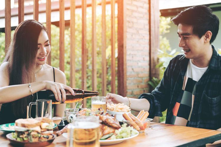 Friends Having Beer At Restaurant