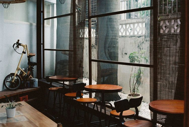 Cafe at Taipei Bicycle Cafe Chair Day Glass Indoors  Large Group Of Objects Table Window Window Frame Wooden Wooden Chair Wooden Post Wooden Table