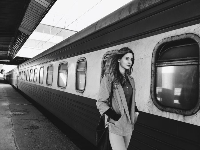 Portrait Of Woman Walking By Train At Railroad Station Platform