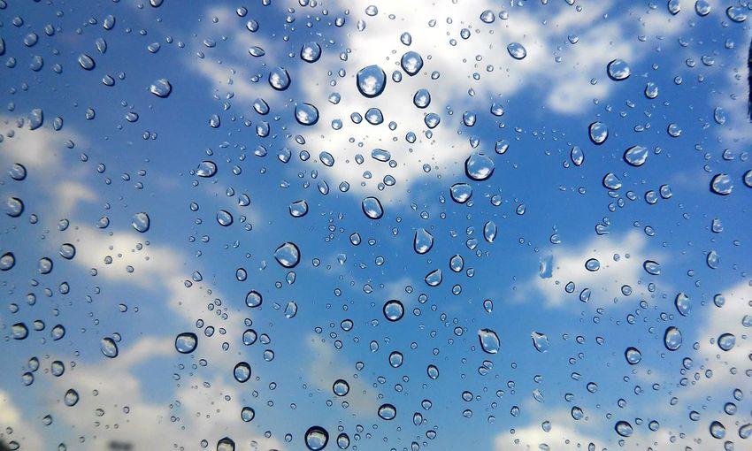 Cloudy Sky Seen Through Wet Window