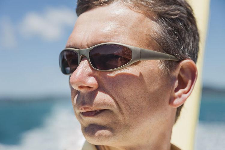 Close-up of mature man wearing sunglasses on boat