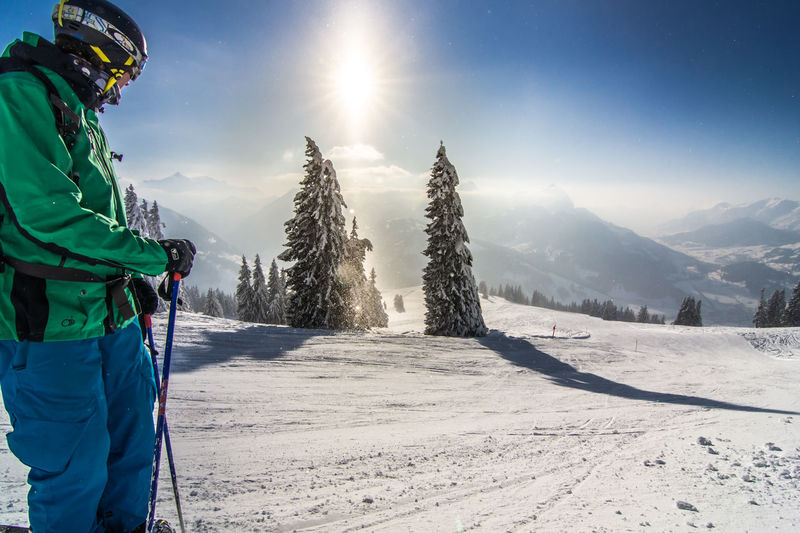 Side View Of Skier Standing On Snow Covered Field