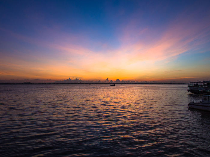Sunrise over the Mekong River, Phnom Penh Cambodia Mekong River Beauty In Nature Cloud - Sky Dramatic Sky Sunrise Water Waterfront