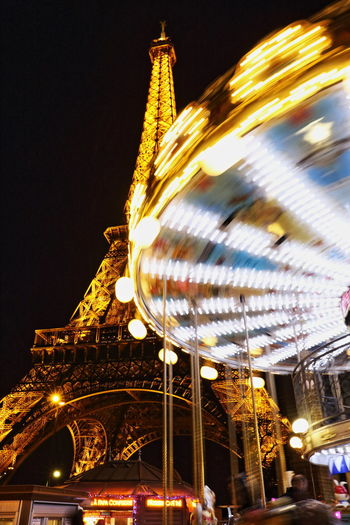 Amusement Park Architecture Built Structure Carousel Clear Sky Eiffel Tower EyeEm Best Shots France Illuminated Night Outdoors Paris Sky Tour Eiffel Tourism Travel Nightphotography Night Photography The Architect - 2017 EyeEm Awards Live For The Story Paint The Town Yellow Capture Tomorrow