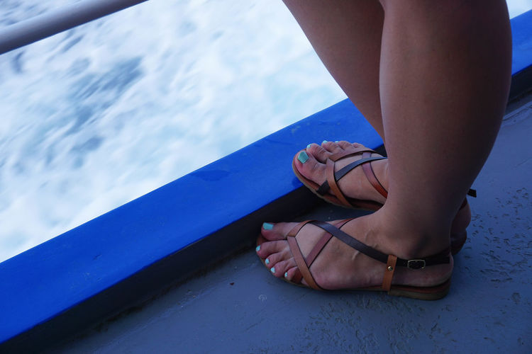 Adult Adults Only Close-up Day Flip-flop Human Body Part Human Foot Human Leg Leisure Activity Low Section One Person One Woman Only Outdoors People Real People Shoe Standing