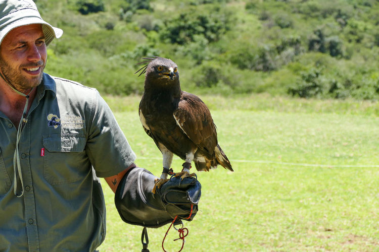 The birds in this collection are all in the African Bird of Prey Sanctuary. They are all rescued birds who are not able to survive in the wild. Animal Themes Bird Bird Handler Bird Of Prey Bird Sanctuary Birds Day Long Crested Eagle One Man Only Outdoors Raptor Smiling