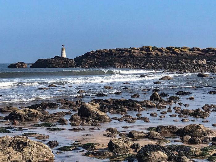 North Sea Scottish Beaches East Lothian Scotland Water Sea Beach Sky Land Rock Rock - Object Beauty In Nature Copy Space Tranquil Scene Clear Sky Motion No People Nature Scenics - Nature Tranquility Outdoors Day Wave Lighthouse