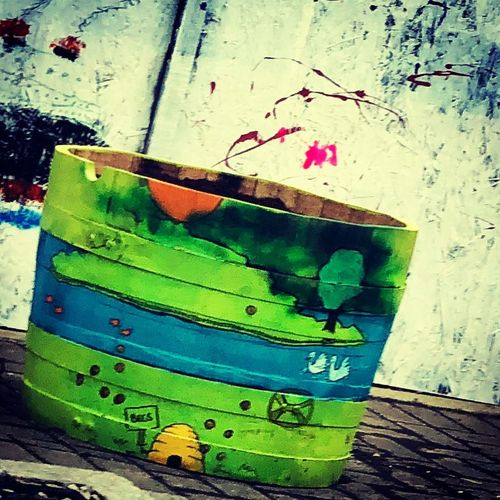 Sustainable Projects Art is Everywhere Arts Culture And Entertainment Recycled Art Reuse Wallspot Planter The River Don Green Color Art And Craft No People Creativity Multi Colored Close-up Wood - Material Paint Outdoors Wall - Building Feature Painted Image Weathered Wood Nature Painted