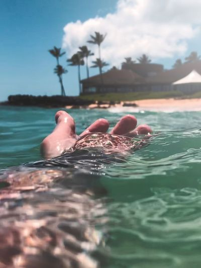 Contact with nature. Paradise Ocean Travel Hawaii Water Cloud - Sky Sea Sky Nature Waterfront Swimming Day Beauty In Nature Human Body Part Leisure Activity Unrecognizable Person Lifestyles Body Part Outdoors