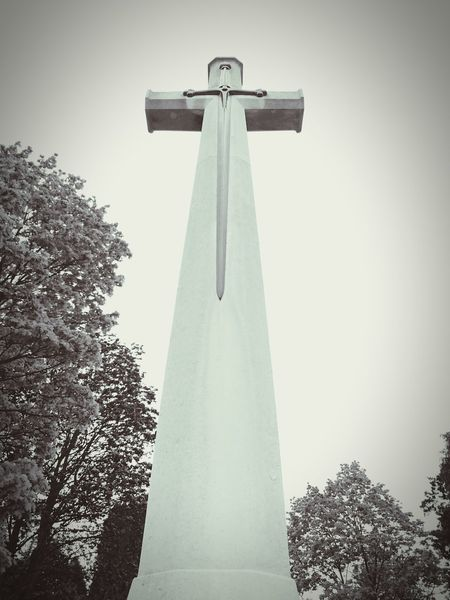 Monument Cross Religion Spirituality Low Angle View Memorial Outdoors Religous Icons Human RepresentationCemetery Photography Religion N Faith No People Low Angle View Statues And Monuments Spirituality Sculpture