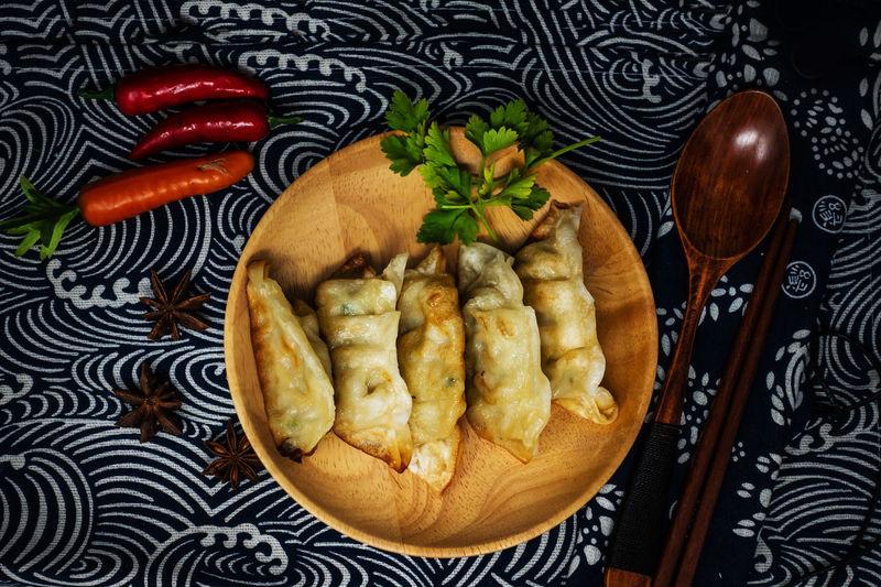 Directly above shot of dumplings served on table against black background