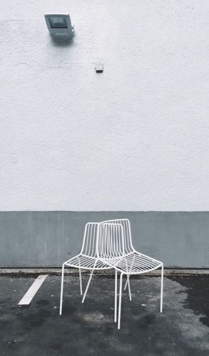 Close-up of chair against wall