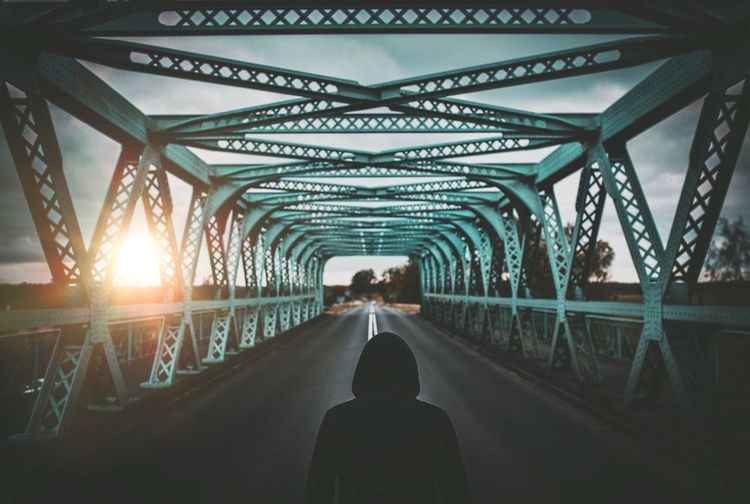 Bridge - Man Made Structure Rear View Real People The Way Forward Built Structure Architecture Transportation Connection Leisure Activity Men Sunlight Lifestyles One Person Day Place Of Heart The Week On Eyem EyeEm Gallery Live For The Story The Great Outdoors - 2017 EyeEm Awards EyeEm Best Edits Streetphotography Outdoors Footbridge Sky People