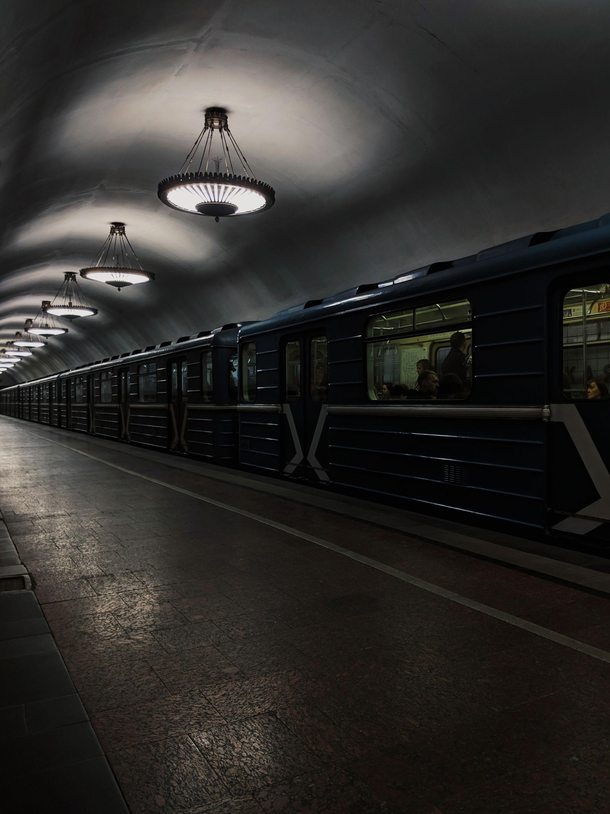 ILLUMINATED TRAIN AT RAILROAD STATION