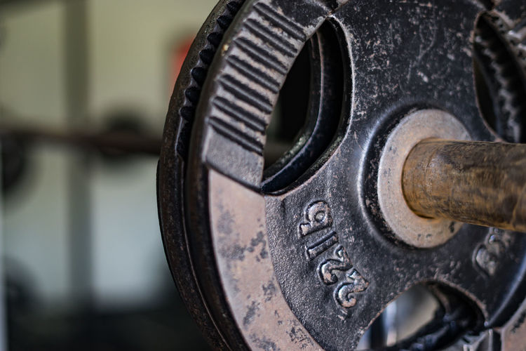 Antique Architecture Barbell Close-up Communication Connection Day Focus On Foreground Gym Time Indoors  Metal No People Number Obsolete Old Selective Focus Shape Strength Technology Weights Western Script Wheel Winemaking