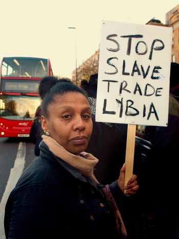 No Borders! No Slavery! Protest demanding an end to auctioning of black Africans in Libya. Following reports of people auctions in Libya. Libyan Embassy. London. UK. 26/11/2017 Black Lives Matter Zuiko Protestor Libya London Slavery Protest Slavery Still Exists Protesters Photojournalism Olympus Stevesevilempire People Auctions Steve Merrick No Borders! No Slavery! London News