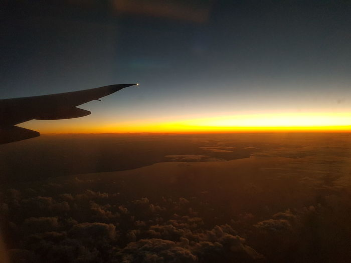Sunset View from 30,000 feet above ground. Sunset Airplane Flying Sky Aircraft Wing Aerial View Travel Journey Scenics Beauty In Nature Nature Sunset_collection Silhouette EyeEmNewHere Photography Beautiful Clouds Red Orange Sky Wonders Of God Amazing Awe Sunlight Samsung Galaxy Note 8