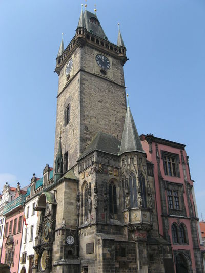 Low angle view of prague astronomical clock against clear blue sky