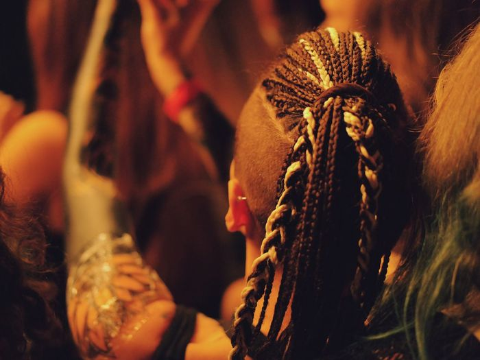 Rear View Of Woman With Braided Hair At Concert