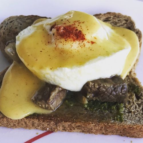 A twist on the classic Benedict: Poached Egg, covered in Hollandaise and a dash of Paprika served on a bed of Pesto Toast and Roasted Tenderloin Tips. #backinthekitchen #dadbreakfastchef #eggs🍳 Egg Breakfast Food And Drink Bread No People Food Poached Toasted Bread Close-up Ready-to-eat