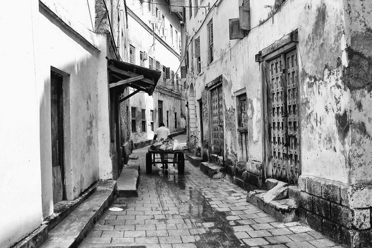 Narrow Alley Amidst Buildings In Town