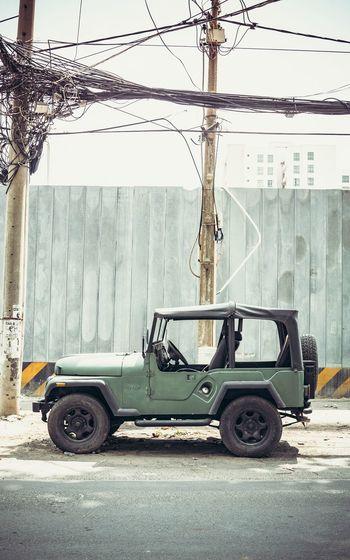 Vintage car on street against building in city