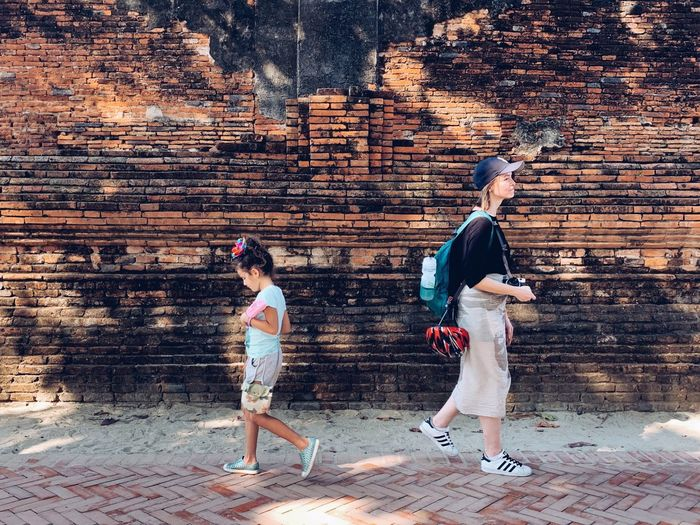 traveling Taste Of Summer  Mother And Daughter Generations Photography Foriegn Walking Around Thai Art Old Town Transportation Tourist Full Length Lifestyles Men Real People People Nature Two People Adult Outdoors Side View