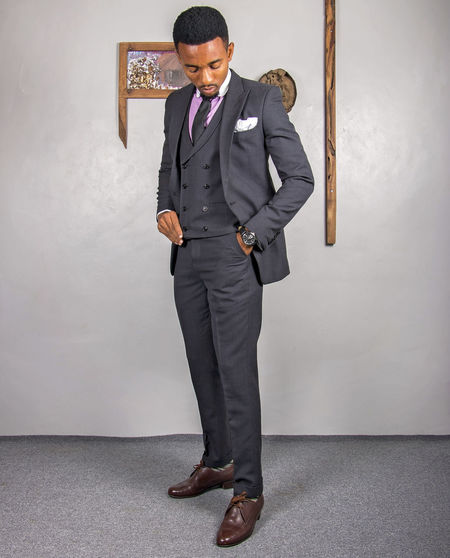 Male Black Model in a Suit Standing Business Adult Indoors  Well-dressed Portrait Young Adult Men Front View Suit Emotion Males  Looking At Camera Clothing Occupation Young Men Black Model Shoes Wristwatch Vintage Style Fashion Fashion Model Brown Shoes