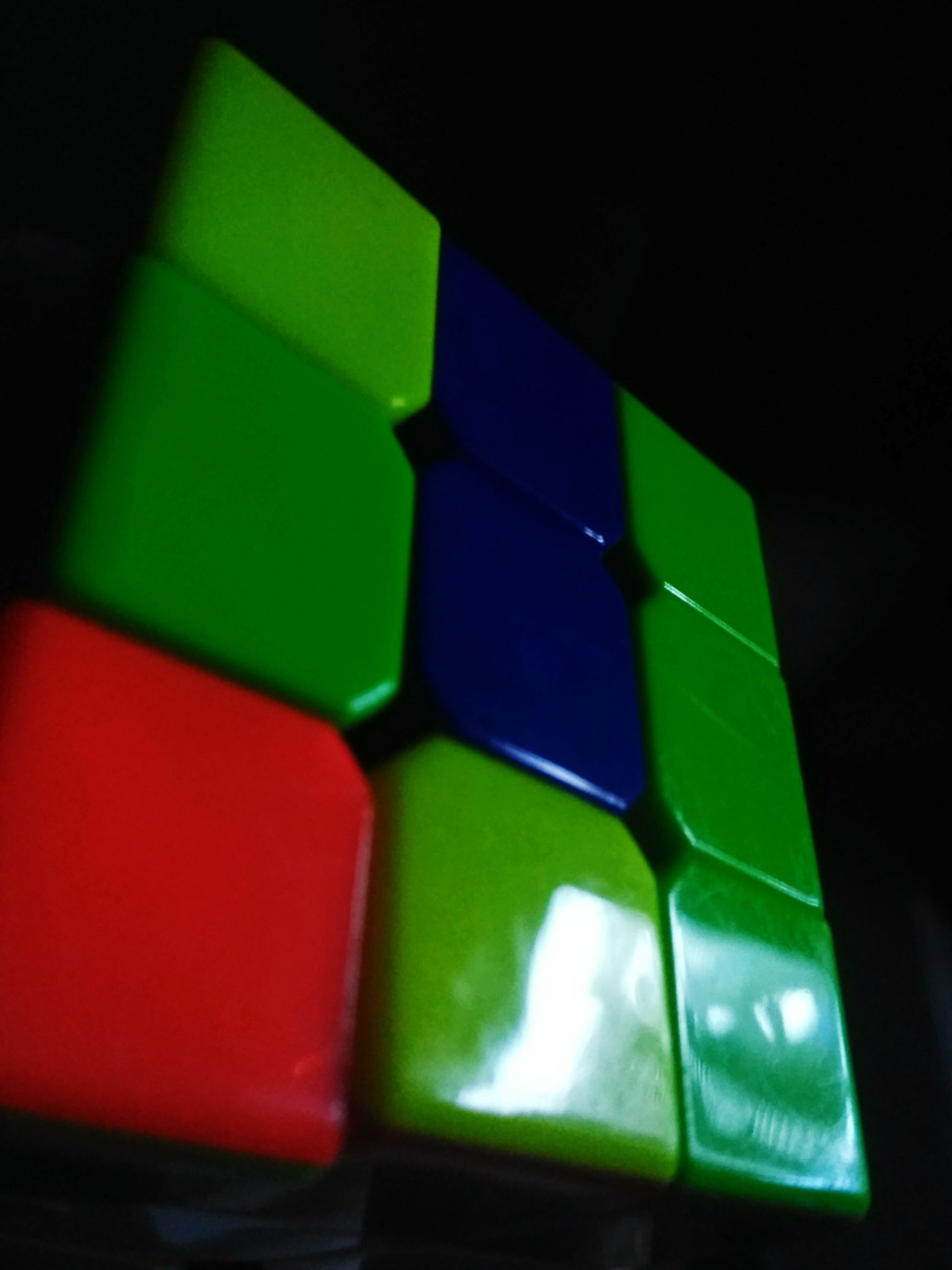 green color, multi colored, toy block, indoors, illuminated, no people, close-up, alphabet, red, technology, black background, day