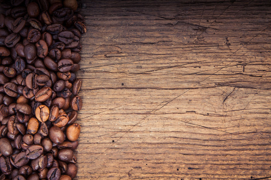 Fine roasted coffee beans on wooden background Coffee Coffee Break Coffee Crop Coffee Growing Coffee Time Coffee ☕ Copy Space Fair Trade Fresh Coffee Roasted Coffee Bean Wooden Background