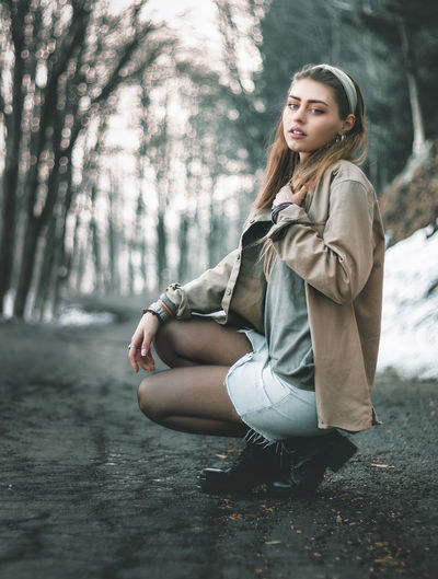 Portrait of beautiful woman in forest