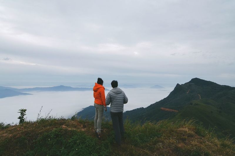 couple on the hill North Of Thailand Vacations Holiday Standing Hiking Trekking Sharing Moments Top Of The Mountains Couple Togetherness Sky Real People Leisure Activity Rear View Cloud - Sky Two People Positive Emotion Beauty In Nature Lifestyles