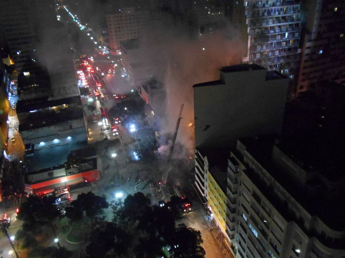 Building Collapse: Inner City Calamity in downtown São Paulo at Largo do Paissandú; 3 am May 1, 2018. The abandoned former Federal Police steel and glass skyscraper, which had been invaded by street people, imploded this early morning and the neighboring building has caught on fire as well. This photo taken about 4 am, May 1, 2018 at Largo do Paissandú. Destruction Largo Do Paissandu May 1, 2018 New On Eyeem Night Photography Susan A. Case Sabir The Week on EyeEm Unretouched Photography About 4 Am Building Collapse Building Fire Building Implosion Burning Building Controlled Chaos Dangerous Situation Downtown São Paulo High Angle View Implosion Responsiveness Smoke - Physical Structure Unexpected Event Urban Photography Urban Strife Focus On The Story