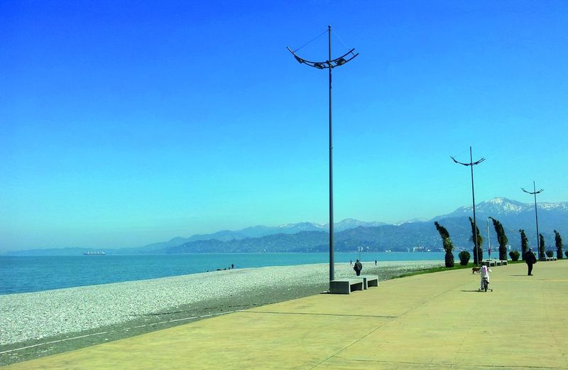 Some places remember me that people born Free... Bay Seafront View Seafront Walk Black Sea Shore Nobody Around Mountain View Sea And Mountain Water Sport Sea Clear Sky Blue Beach Sky Electricity Pylon