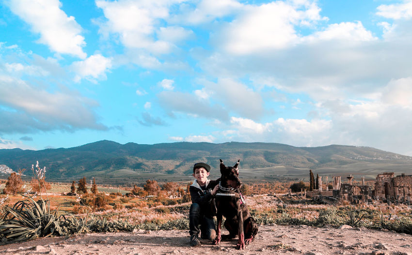 Dobermann Cloud - Sky Doberman  Dog Domestic Domestic Animals Lifestyles Mountain Mountain Range Nature People Pets Real People Scenics - Nature Sky