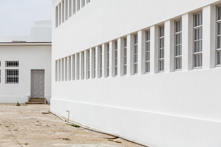 The Architect - 2019 EyeEm Awards Peniche Fortress Architecture Built Structure Building Exterior Building Day White Color No People Nature City Outdoors Window Wall - Building Feature Residential District Sunlight Modern Exterior Footpath Office House Land Apartment
